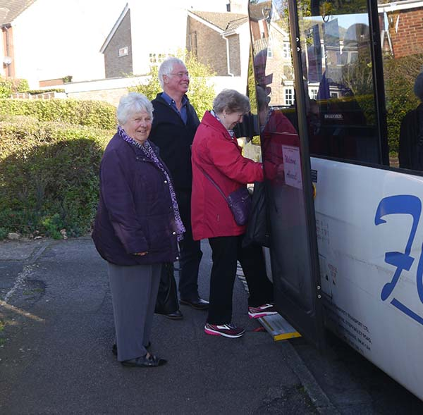 driver helping people to get on the bus
